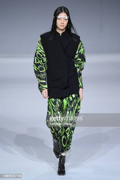 A model walks on the runway of the DAMOWANG Show by designer Lei Han on day 4 of China Fashion Week at 751DPARK on October 27 2020 in Beijing China
