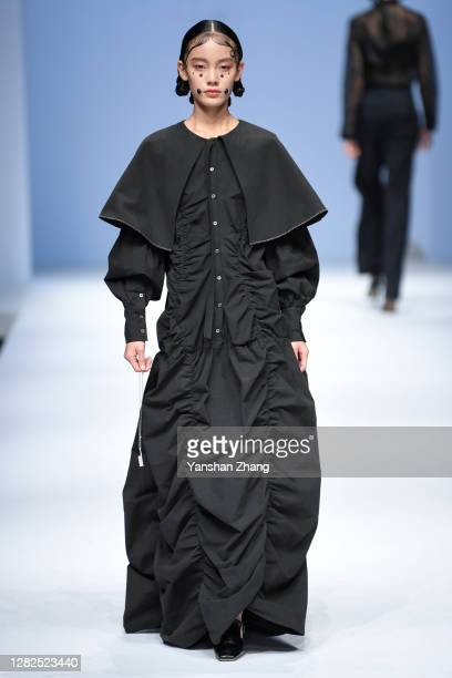 A model walks on the runway of the PINHUI Show by designer Pinghui Zhao on day 4 of China Fashion Week at 751DPARK on October 27 2020 in Beijing China