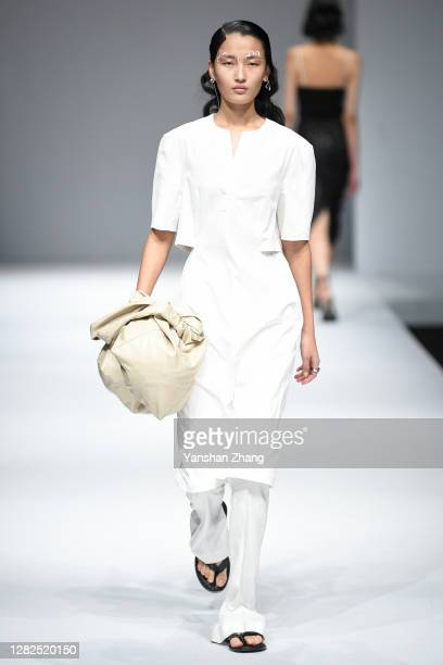 Model walks on the runway of the YOEYYOU Show by designer You Yue on day 4 of China Fashion Week at 751D.PARK on October 27, 2020 in Beijing, China.