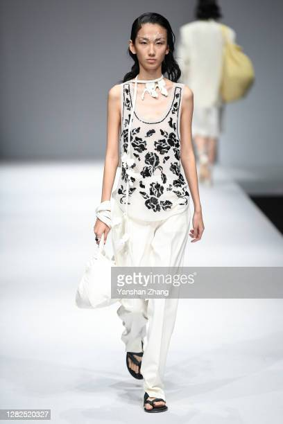 A model walks on the runway of the YOEYYOU Show by designer You Yue on day 4 of China Fashion Week at 751DPARK on October 27 2020 in Beijing China