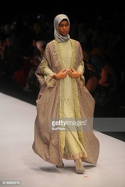 A model walks on the runway to present Indonesian Muslim designer Anniesa Hasibuan during the Jakarta Fashion Week in Jakarta Indonesia on October 28...