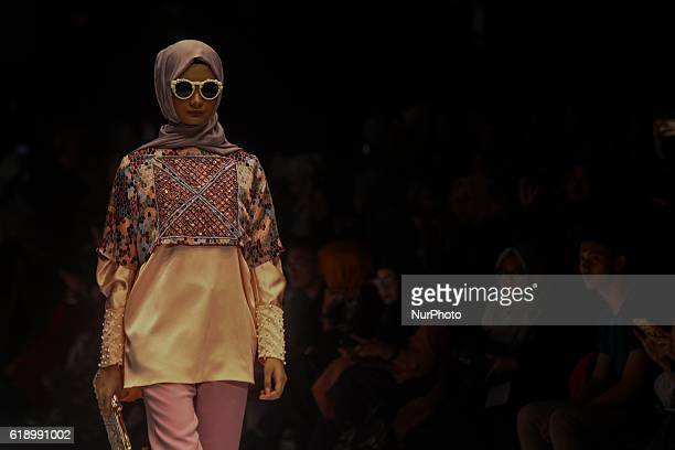 A model walks on the runway to present Indonesian Muslim designer Anniesa Hasibuan during the Jakarta Fashion Week in Jakarta Indonesia on October 28...