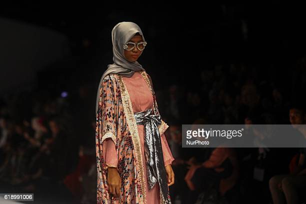 Model walks on the runway to present Indonesian Muslim designer, Anniesa Hasibuan during the Jakarta Fashion Week in Jakarta, Indonesia, on October...