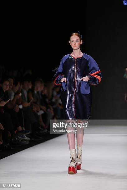 """Model walks on the stage as she presents the Istanbul Moda Academy collection named """"New Gen"""" during the Mercedes-Benz Fashion Week Spring/Summer..."""