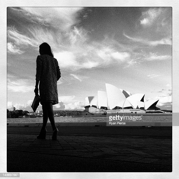 Model walks past the Sydney Opera House during Mercedes-Benz Fashion Week Australia Spring/Summer 2012/13 at Overseas Passenger Terminal on May 1,...