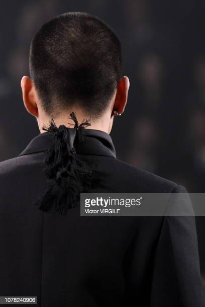 A model walks runway during the Dior PreFall 2019 Men's Collection fashion show at Telecom Center on November 30 2018 in Tokyo Japan