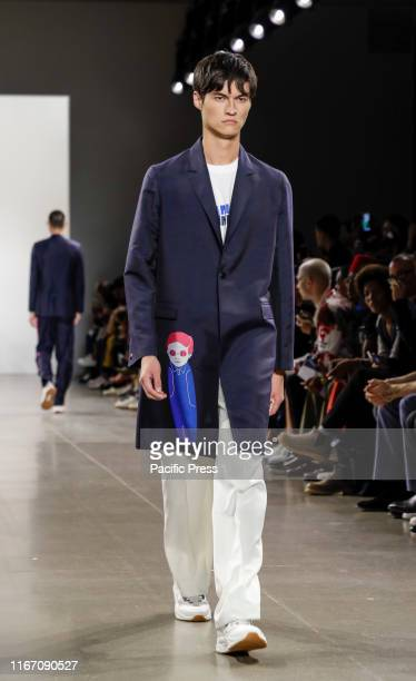 A model walks runway for Carlos Campos Spring/Summer 2020 mens collection during New York Fashion Week at Spring Studios Manhattan