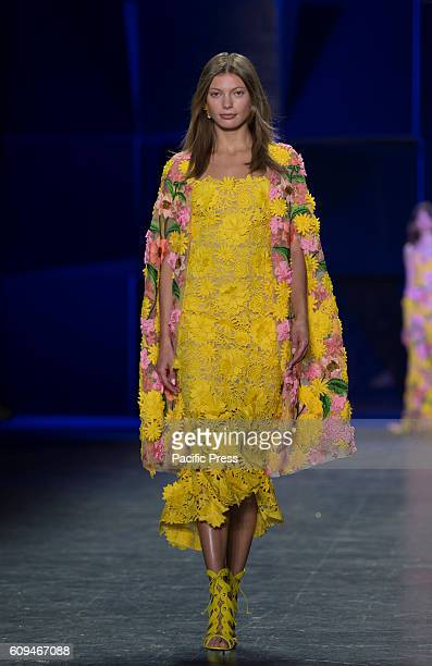 Model walks runway for collection by Naeem Khan during New York Fashion week Spring/Summer 2017 at Moynihan Station