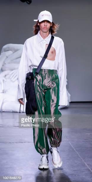 A model walks runway for Feng Chen Wang Spring/Summer 2019 runway show during NY Fashion Week Men's at Industria Studios Manhattan
