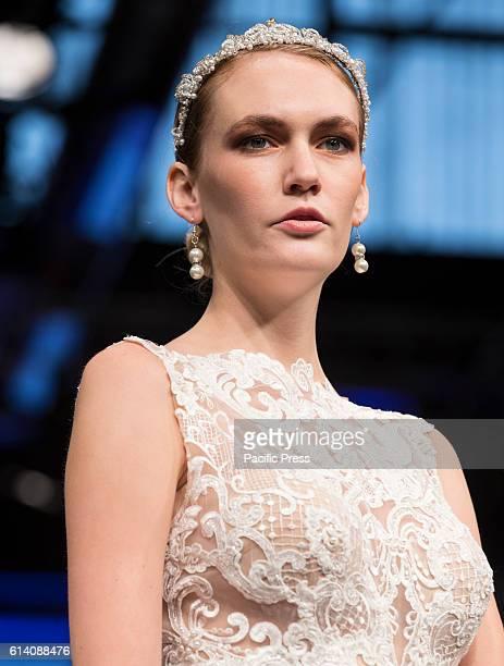 Model walks runway for Israeli designers show by Adam Zohar during New York Bridal week at Pier 94