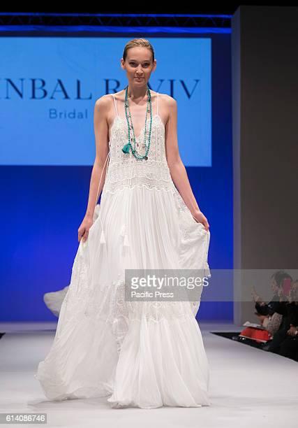 Model walks runway for Israeli designers show by Inbal Raviv during New York Bridal week at Pier 94
