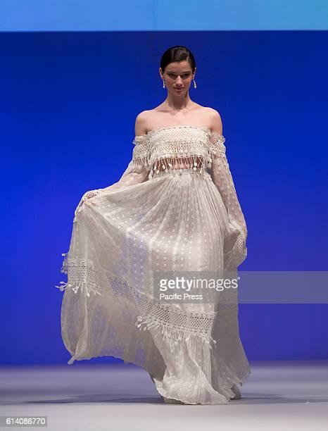 Model walks runway for Israeli designers show by Meital Zano during New York Bridal week at Pier 94