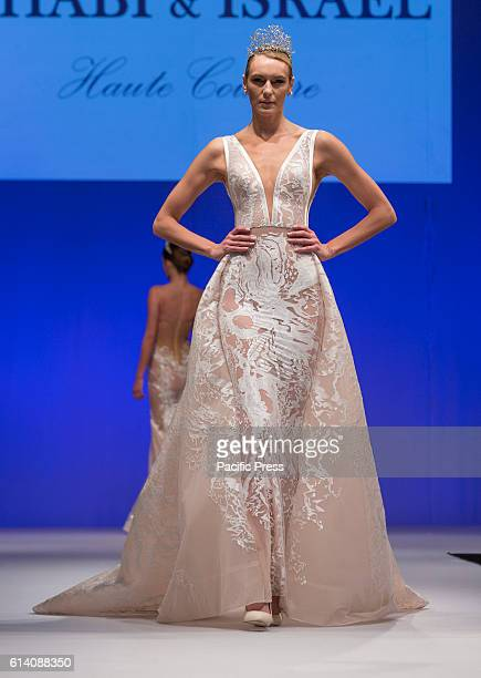 Model walks runway for Israeli designers show by Shabi Shamil and Israel Mor during New York Bridal week at Pier 94