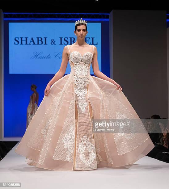Model walks runway for Israeli designers show by Shabi Shamil and Israel Mor during New York Bridal week at Pier 94