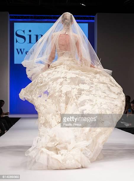 Model walks runway for Israeli designers show by Simijan Bozaglo during New York Bridal week at Pier 94