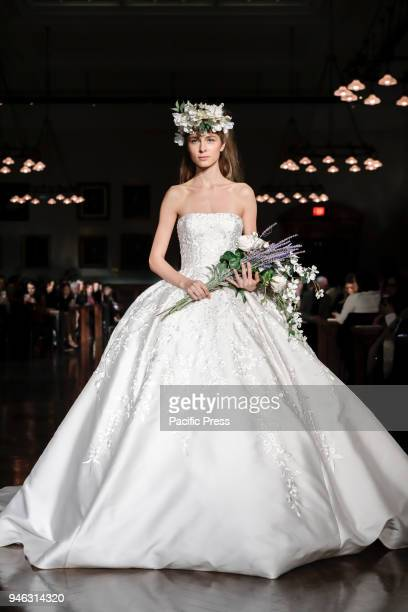 5ecb4a4ed4d2 A model walks runway for Reem Acra Bridal Spring/Summer 2019 runway show  during NY. Editorial use only