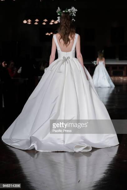 A model walks runway for Reem Acra Bridal Spring/Summer 2019 runway show during NY Bridal Wweek at NY Public Library Manhattan