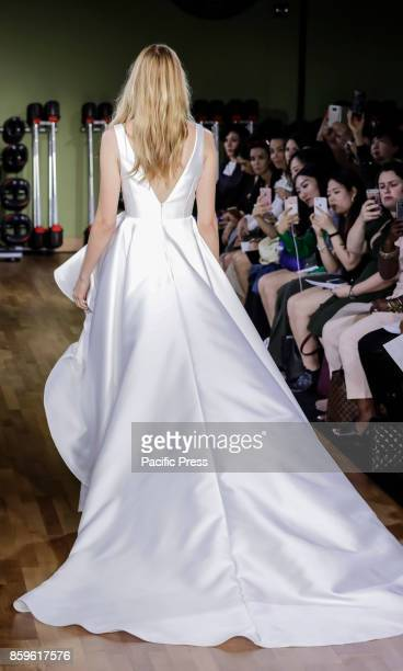 Model walks runway for RIVINI & Alyne Fall/Winter 2018 Bridal Collection by Rita Vinieris at TMPL GYM during New York Bridal week, Manhattan.