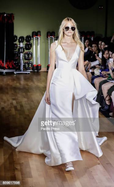 Model walks runway for RIVINI & Alyne Fall/Winter 2018 Bridal Collection by Rita Vinieris at TMPL GYM during New York Bridal week, Manhattan.