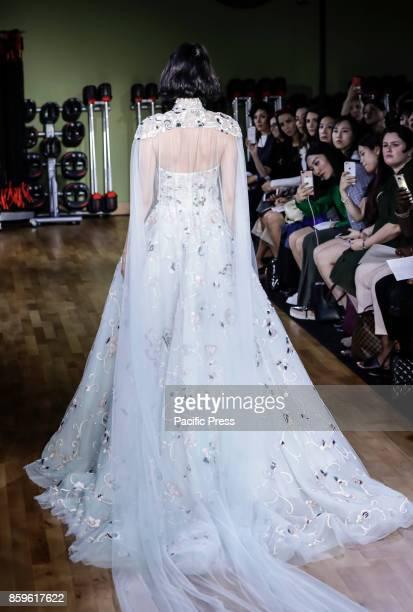 A model walks runway for RIVINI Alyne Fall/Winter 2018 Bridal Collection by Rita Vinieris at TMPL GYM during New York Bridal week Manhattan