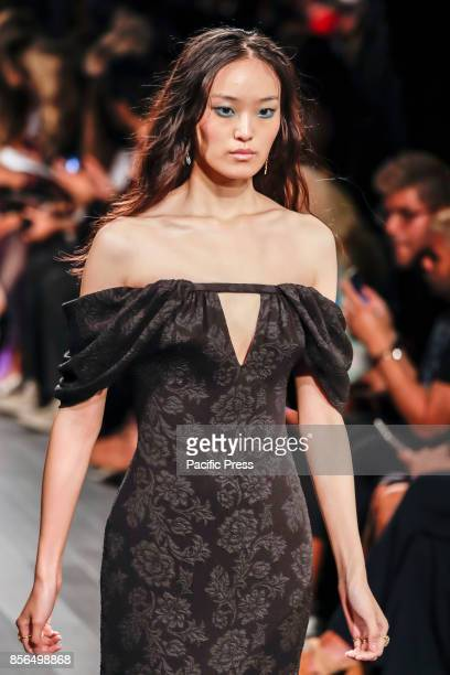 A model walks runway for the Tadashi Shoji Spring/Summer 2018 runway show during New York Fashion Week at Skylight Clarcson Sq Manhattan