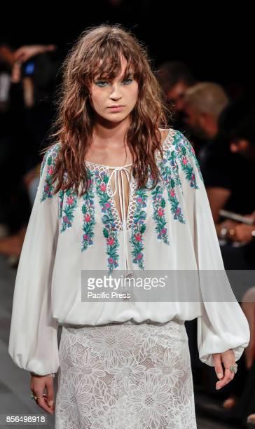 A model walks runway for the Tadashi Shoji Spring/Summer 2018 runway show during New York Fashion Week at Skylight Clarcson Sq Manhattan