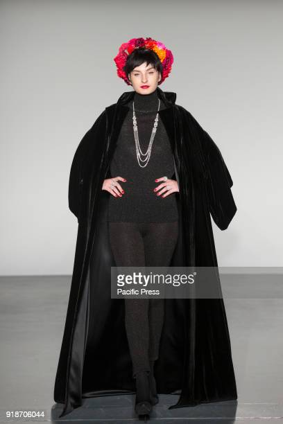 Model walks runway for Zang Toi Autumn/Winter collection with jewelry by Twila True at New York Fashion Week at Pier 59