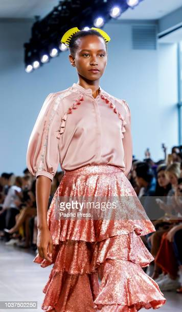 A model walks runway to present Marcel Ostertag Spring/Summer 2019 collection during New York Fashion Week at Spring Studios Manhattan