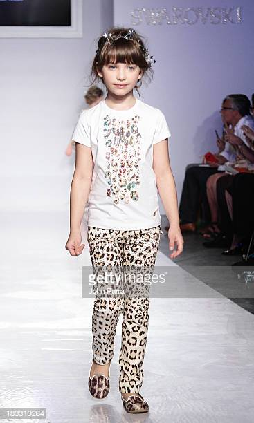 Model walks the at the Roberto Cavalli Junior preview during the Swarovski at petiteParade NY Kids Fashion Week in Collaboration with VOGUEbambini on...