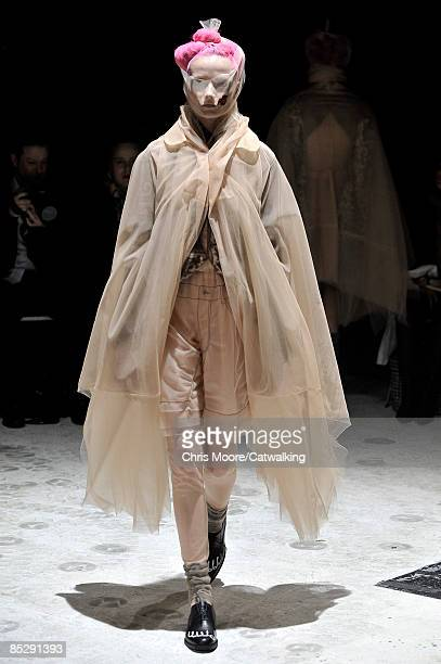 A model walks the catwalk at the Comme des Garcons ReadytoWear A/W 2009 fashion show during Paris Fashion Week on March 7 2009 in Paris France
