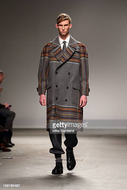 A model walks the catwalk at the ETautz show during the London Collections MEN AW13 at The Old Sorting Office on January 9 2013 in London England