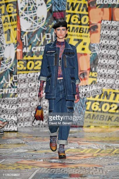 A model walks the catwalk at the House of Holland AW19 London Fashion Week catwalk show showcasing the limitededition Vype ePen 3 and vaping pendant...