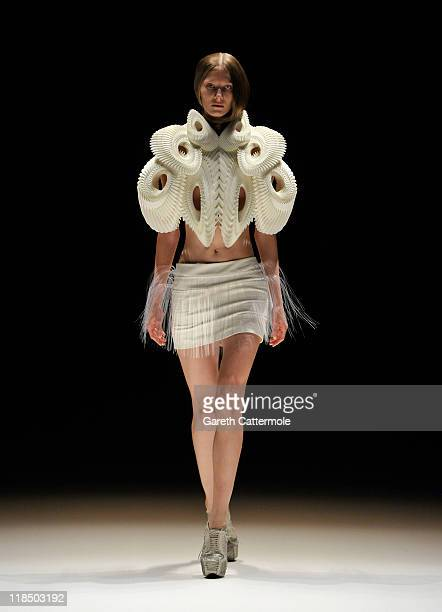 A model walks the catwalk at the Iris van Herpen Show during MercedesBenz Fashion Week Berlin Spring/Summer 2012 at the Brandenburg Gate on July 8...