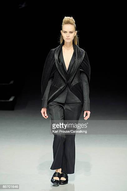 Model walks the catwalk at the Issey Miyake Ready-to-Wear A/W 2009 fashion show during Paris Fashion Week at Le Carrousel du Louvre on March 6, 2009...