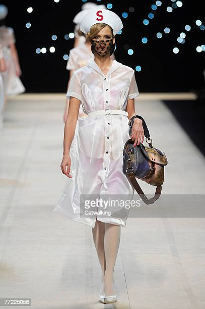 Model walks the catwalk at the Louis Vuitton fashion show, during the Spring Summer 2008 collection show part of Paris Fashion Week at the Cour...