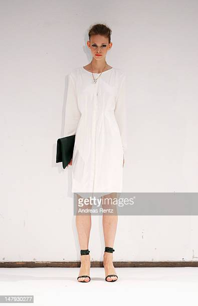 A model walks the catwalk at the Malaikaraiss Show during MercedesBenz Fashion Week Spring/Summer 2013 on July 6 2012 in Berlin Germany