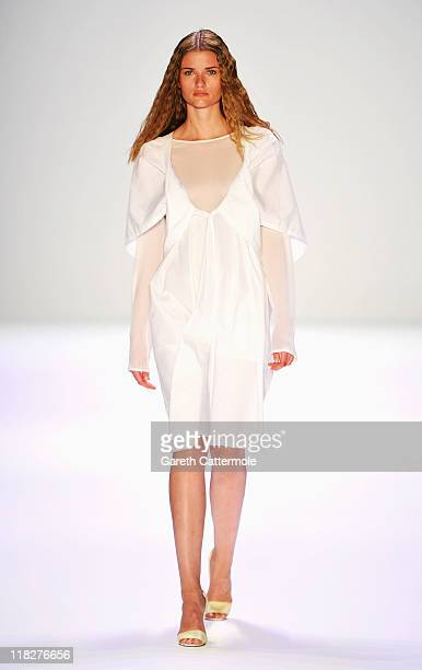 A model walks the catwalk at the Michael Sontag Show during MercedesBenz Fashion Week Berlin Spring/Summer 2012 at the Brandenburg Gate on July 6...