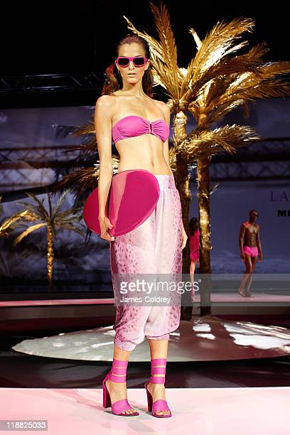A model walks the catwalk at the 'Michalsky StyleNite' during the MercedesBenz Fashion Week Berlin Spring/Summer 2012 at Tempodrom on July 8 2011 in...