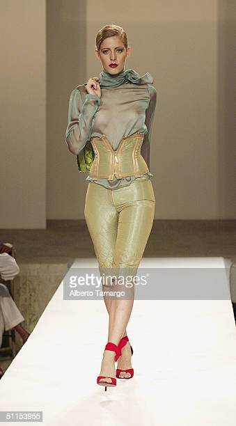 A model walks the catwalk at the new Sylvia Tcherassi collection at The Mir Foundation Fashion Show and Gala At La Romana on August 8 2004 at Casa De...