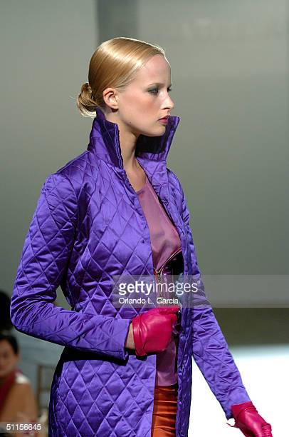 Model walks the catwalk at the new Sylvia Tcherassi collection at The Mir Foundation Fashion Show and Gala At La Romana August 8, 2004 at Casa De...