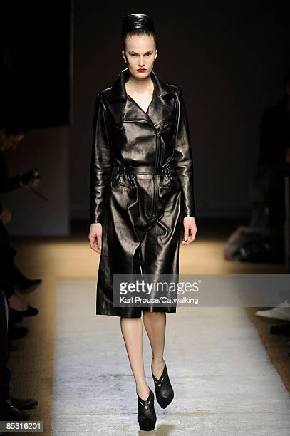 A model walks the catwalk at the Yves Saint Laurent ReadytoWear A/W 2009 fashion show during Paris Fashion Week at Palais de Tokyo on March 9 2009 in...