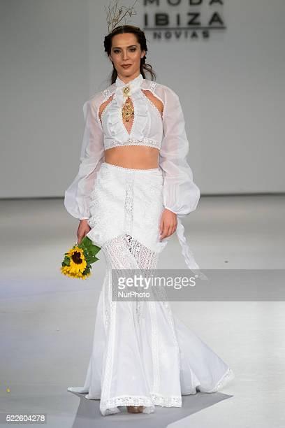 A model walks the catwalk during the bridal fashion designer Adlib Moda Ibiza Novias show during the Pasarela Costura held at the Cibeles Palace on...