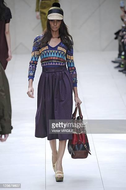 A model walks the catwalk during the Burberry Prorsum Spring/Summer 2012 show at London Fashion Week at Kensington Gardens on September 19 2011 in...