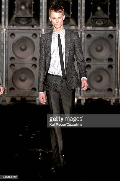 A model walks the catwalk during the Cerruti fashion show as part of Spring Summer 2008 Paris Menswear fashion week on July 1 2007 in Paris France