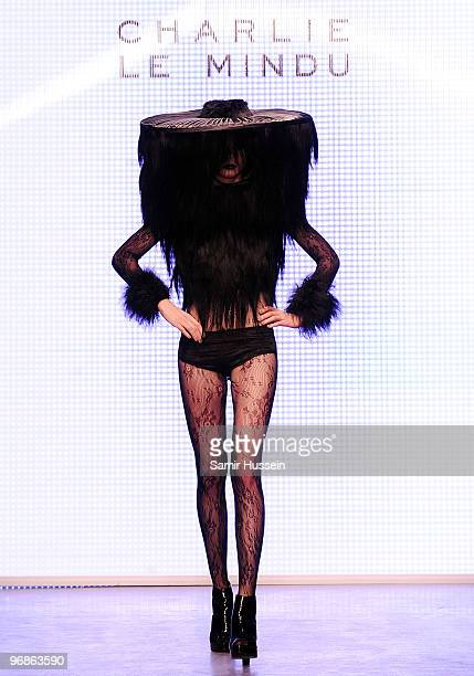 A model walks the catwalk during the Charlie Le Mindu Autumn/Winter London Fashion Week catwalk show at On Off on February 19 2010 in London England