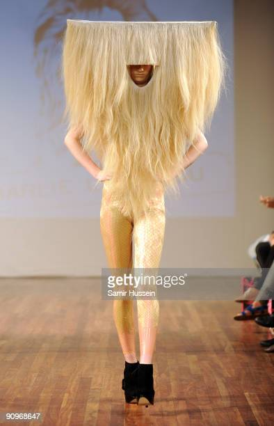 A model walks the catwalk during the Charlie Le Mindu Spring/Summer 2010 show as part of Blow Presents during London Fashion Week at the Royal...