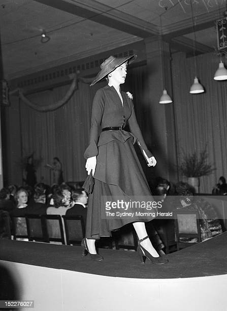 A model walks the catwalk during the Christian Dior fashion parade at David Jones Factory on July 31 1948 in SydneyAustralia