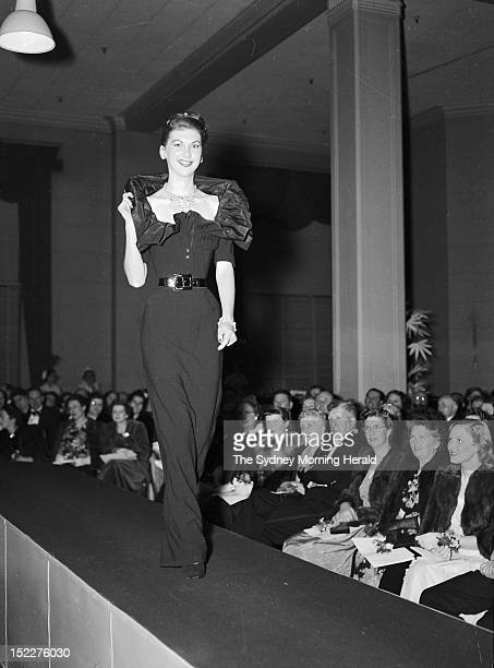 Model walks the catwalk during the Christian Dior fashion parade at David Jones Factory on July 31, 1948 in Sydney,Australia .