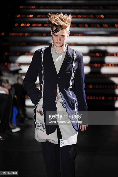 A model walks the catwalk during the Comme Des Garcons Homme Plus Menswear fashion show part of Paris Fashion Week on the 18th of January 2008 in...