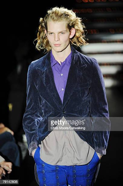Model walks the catwalk during the Comme Des Garcons Homme Plus Menswear fashion show part of Paris Fashion Week on the 18th of January 2008 in...